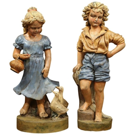 Pair of Mid-20th Century French Painted Iron Statues of Boy and Girl with Ducks
