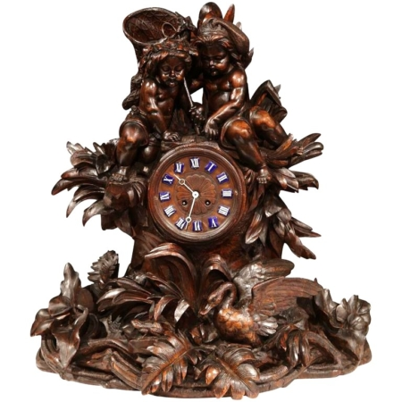 Large 19th Century Swiss Carved Walnut Black Forest Mantel Clock with Cherubs